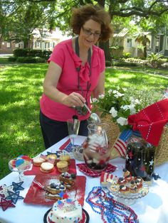 Green Palm Inn's Diane McCray finalizing July 4th holiday picnic details in Greene Square, near the historic cottage inn. Photo (c) 2013 Green Palm Inn / Sandy Traub.