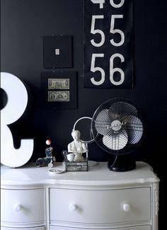 black walls, white dresser