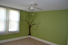 Curly tree in a corner, move right slightly to cover more of large wall in G's room