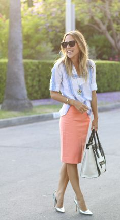 Blue striped shirt, coral pencil skirt, silver pumps, pastel bauble pendant, and two-tone black/white bag