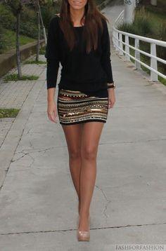 Plain black top, patterned skirt, nude heels
