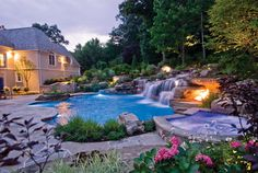 An immense rock waterfall complements the nautral beauty of this freeform swimming pool  and patio. Photo courtesy of Cipriano Custom Swimming Pools & Landscaping; photography by Ed Pirone http://www.luxurypools.com/builders-designers/cipriano-landscape-design.aspx