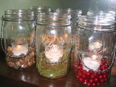 Mason Jar, Spanish Moss, Tealight/Votive.  SIMPLE centerpiece!