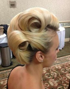 Awesome updo posted by Modern Salon. I want to take a shot at replicating it