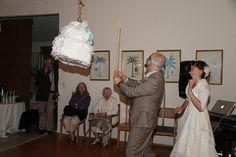 Instead of smashing cake into each other's faces -- smash a cake-shaped pinata at your reception!