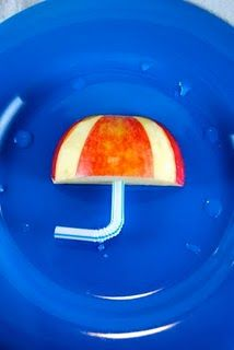 "Umbrella snack with apple and a straw - great for ""weather week"" at preschool"