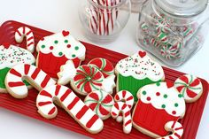 Completely delightful Candy Cane, Cupcake, and Peppermint Candy shaped decorated Christmas Cookies....This would make a cute table runner made with felt.