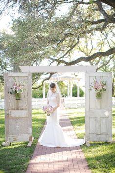 Vintage doors as ceremony entrance or backdrop | Photo by Caroline Joy