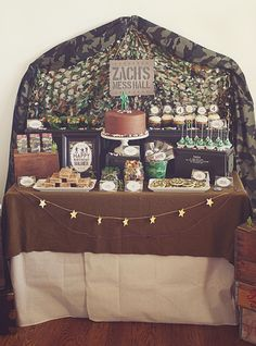 Creative Toy Soldier Camo Birthday Party -– Mess Hall food & dessert table with food trays, soldier-approved treats & a camo netting backdrop