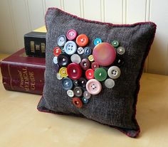 great use for all those buttons hanging around #pillow