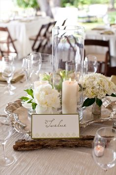 simple, inexpensive, candles in hurricane vases make a lovely centerpiece