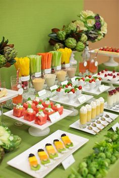 Healthy eaters will rejoice over a bright and attractive fruit and veggie spread that includes watermelon and caprese salads as well as yogurt parfait shots. dessert tables, healthy party snacks, healthy party foods, healthy snacks, party tables, healthy foods, healthy appetizers, food bar, parti