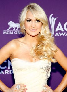 Carrie Underwood walks the red carpet at the 2012 Academy of Country Music Awards  More Photos: http://bit.ly/HexM8V  Photo Credit: AP Photo/Isaac Brekken
