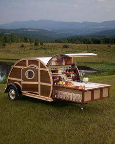 From the Neiman-Marcus gift catalog, a teardrop trailer that converts into an elaborate, fully loaded and beautiful mobile bar!