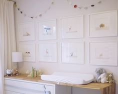White-on-white gallery wall adds simple interest.  #gallerywall #white #nursery #wallart