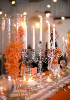 beautiful modern table with lucite candleabras- orange and gray wedding
