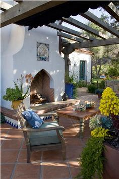 Patio with pergola and fireplace outside a Spanish Mediterranean house