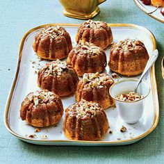 This mini Bundt cake recipe features pureed sweet potatoes, raisins, rum, and toasted pecans along with cinnamon and nutmeg and is a perfect pick-up treat for a holiday dessert party.