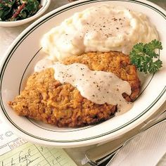 Chicken Fried Steak with Mashed Potatoes and Peppered Cream Gravy.