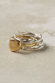 """love this """"sticks and stones"""" ring set from anthropology"""