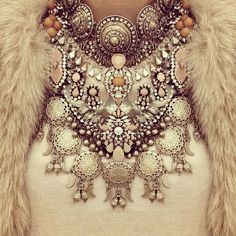 layered necklaces with jewels and crystals