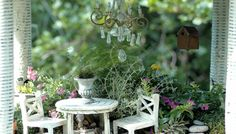 Furniture for fairy garden? Love the chandelier.