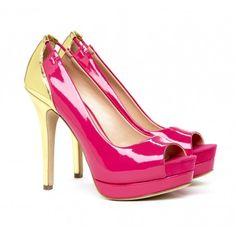 Peep toe platform pump with contrasting heel and colorblock detail.