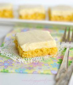 Gooey Lemon Cake Bars: easy lemon bar recipe using a cake mix and a cheesecake topping. EASY too!