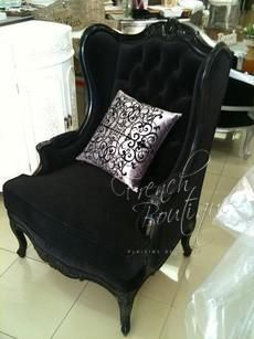 Black velvet wingback chair.