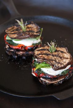 Grilled Eggplant Mozzarella Stacks-  Sliced grilled eggplant, portobello mushrooms, sautéed spinach, roasted red peppers, fresh mozzarella, fresh basil, and a drizzle of pesto or pesto oil. Stacks held together with a sprig of rosemary.