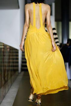 "yellow ""backless"" dress"