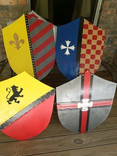 Shields made from foam core board, paint, duct tape (designs), and brass tacks