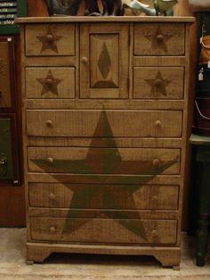 Painted stars, very nice look on this bureau...