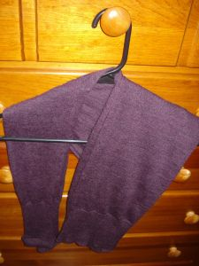 how to hang sweaters - this works really well - they take up more space in the closet hanging like this rod but since they don't hang so low, you can easily set shelves inside the closet on the floor to hold bins or baskets of your other garments that don't need hangers.
