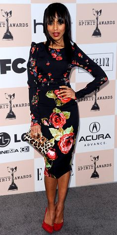 Kerry Washington in floral dress, leopard clutch, and red suede Sergio Rossi pumps