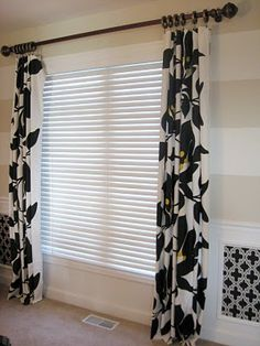 Easy window update: use tablecoths instead of curtain panels. Pre-hemmed, washable.