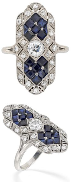 Art Deco-style sapphire and diamond table ring. The center stone is an old brilliant-cut diamond (approx 0.50 carats), set vertically to either side with seven square-cut sapphires and surrounded by a diamond border. I think it looks like a quilt, with the way the gems are fitted perfectly together. Via Diamonds in the Library.