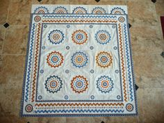 Look at the half-bloack border that Sue Garman has started for her Target Practice quilt.  Love it!