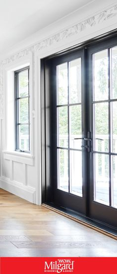 Black French patio doors add a dark elegance to this farmhouse dining room. French doors are available in both sliding door and swinging door operating styles, so, you can achieve the look, no matter which operating style you choose. Featuring Ultra™️ Series Patio Doors in Black Bean. #patiodoorideas #frenchpatiodoors #patiodoormakeover #replacementpatiodoors #newpatiodoorideas