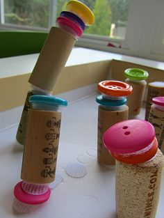 Button and cork towers { reminds me of Seuss illustrations }