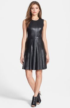 Love the classic fit of this dress with paired with edgy leather