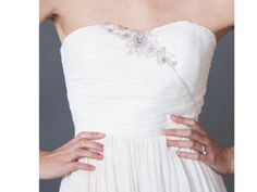 This eco gown features a little floral detailing for your spring wedding | Fair Trade Sweetheart Wedding Gown | Green Bride Guide