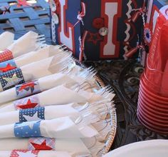 Make easy napkin holders using 4th of July paper strips and vinyl as stickers!