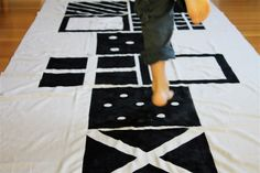 Rainy days never get in the way with this #DIY #hopscotch mat out for play!