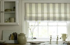 Roman shades :)  <-- for the kitchen