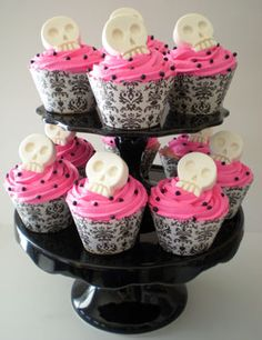 cupcake papers can be found at walmart,you can buy pink frosting or strawberry, black sprinkles and candy of choice... tier can be found at walmart also for parties :)