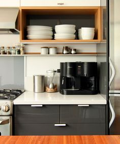 shiny grey cabinets, microwave bottom
