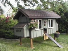 How about this coop? <3 someone else is crazy for chickens!!! linked to plan sets! Only thing I would change is the lil door, I would paint the inside so when it hangs its puuuurdy too! lol  Love that the entire back OPENS UP!!