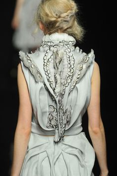 elaborate fashion details - dress back with feathers and textured pattern