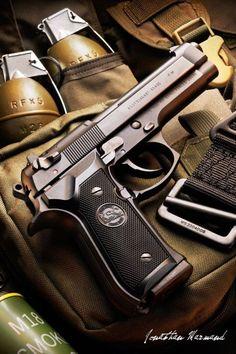 Beretta M9 semi-automatic pistol and hand grenades